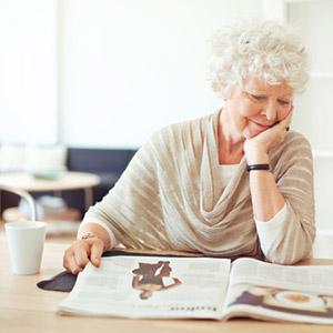 Senior woman reading a magazine