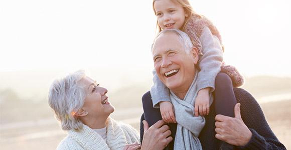 Grandparents holding a grandchild